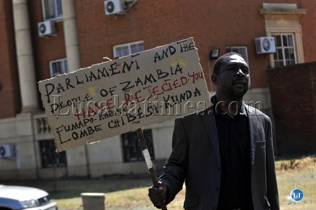 FILE: UPND deputy secretary general Kuchunga Simusamba protesting against the Chief Justice Lombe Chibesakunda outside the Supreme Court