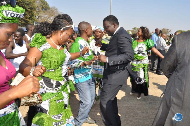 Kennedy Kamba and Stephen Masumba joins PF cadres in dancing shortly before President Michael Sata arrived at Harry Mwaanga Nkumbula International Airport for the opening of the  UNWTO 20th General Assembly   -Picture and caption by THOMAS NSAMA