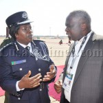 Inspector General of Police Stella Libongani  speaks with Tourism Permanent secretary George Zulu shortly before President Michael Sata  arrived  at Harry Mwaanga Nkumbula International Airport for the opening of the  UNWTO 20th General Assembly   -Picture and caption by THOMAS NSAMA