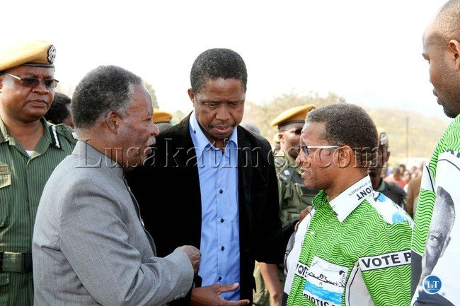 FILE: President Michael Sata with Home affairs minister Edgar Lungu (c) and   PF Mkaika constituency parliamentary candidate David Phiri after a  rally to drum up support for Phiri  in Katete on Sept 2,2013 -Picture by THOMAS NSAMA
