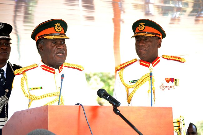 President Michael Sata (left) addresses Zambia National Service (ZNS) officer cadets as ZNS Commandant Lieutenant General Nathan Mulenga (right) looks on at a commissioning parade in Kafue yesterday