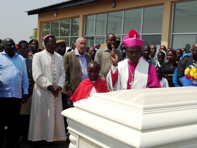 Chipata Diocese Catholic Bishop George Lungu,Vice President Dr Guy Scott and Eastern Province Minister Malozo Sichone witnessing the blessings of the casket of Cardinal Medardo Mazombwe  by Auxilliary Bishop Benjamin Phiri at Chipata Airport in Chipata