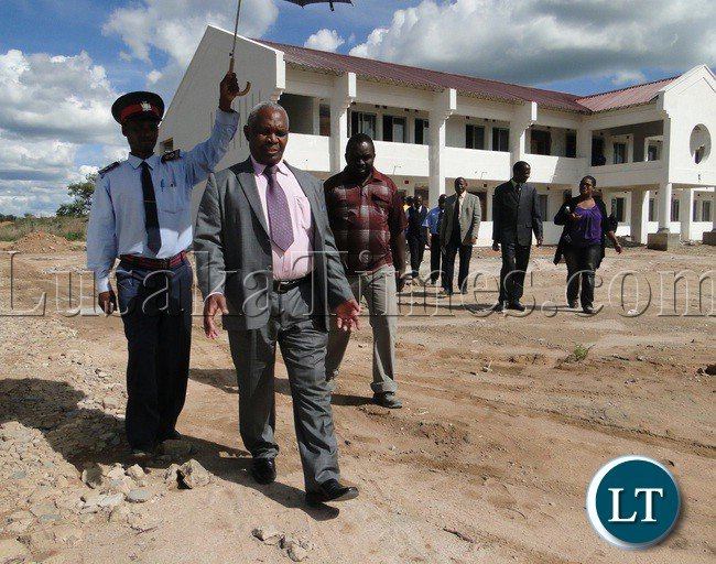 Education deputy minister Professor Neverlyn Wilombe inspecting the on-going construction works at Robert Makasa University in Chinsali Muchinga Province. Government has engaged Flame Construction Company to carry out the works which are now are 98 percent complete