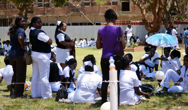 Protesting nurses at the University Teaching Hospital in Lusaka relax under a tree shade.
