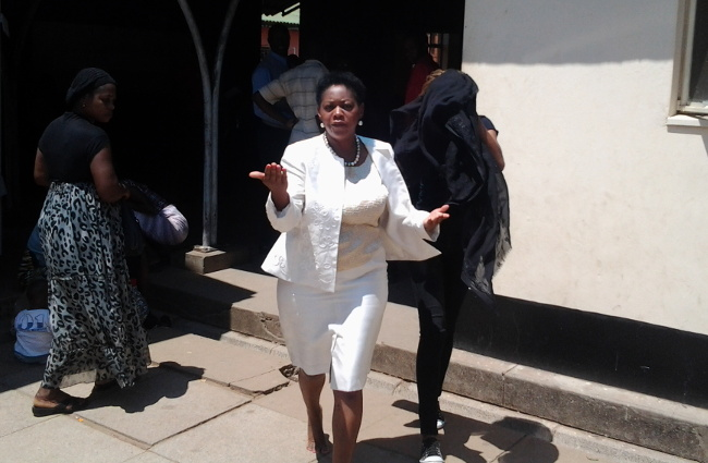 Mrs Zimba charges at cameraman outside court