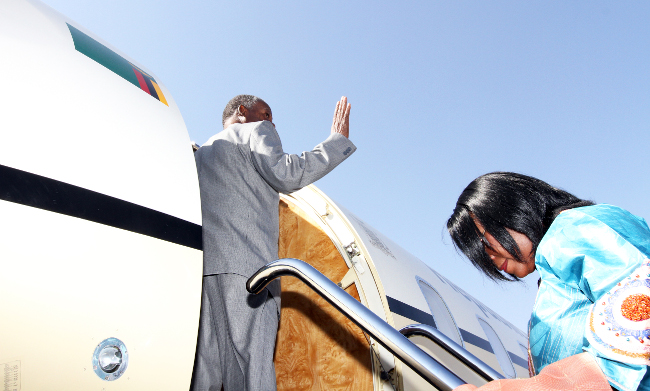 President Sata with First Lady Dr Kaseba boards plane in Addis-1894