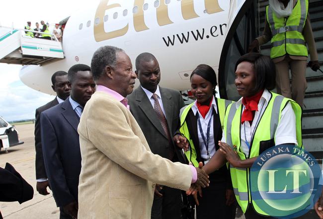 President Michael Sata greets Emirates Ground Crew  at Kenneth Kaunda international airport aboard Emirares Flight