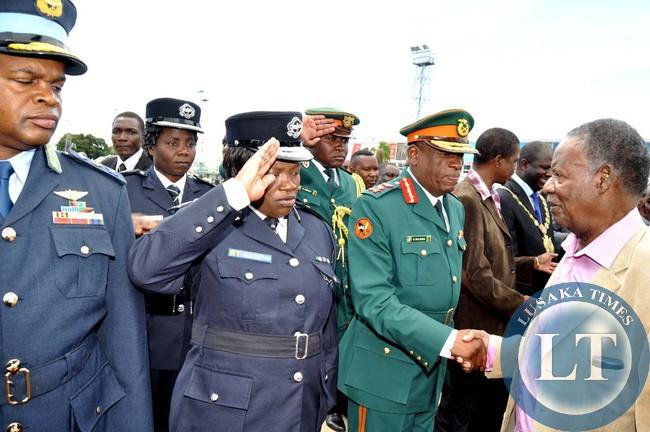 President Sata greets Service Chiefs on arrival at Kenneth Kaunda International Airport in Lusaka