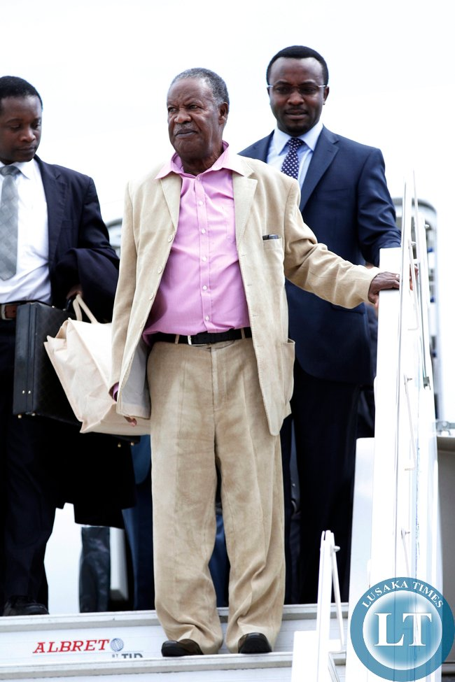President Sata disembarks from an Emirates plane at the Kenneth Kaunda international airport