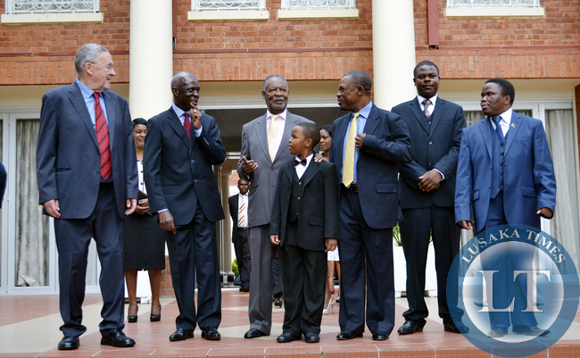 President Michael Sata with Vice President Guy Scott ( left), newly appointed Ambassador Designate to Egypt Ali Simwinga, ten-year-old Blessings Mumba, the grandson of newly appointed Commissioner of Police at Sate House Godwin Phiri (not in picture), Justice Minister Wynter Kabimba and newly appointed public policy specialists Pride Kabuswe and Robert Kasezya (right) at State House today