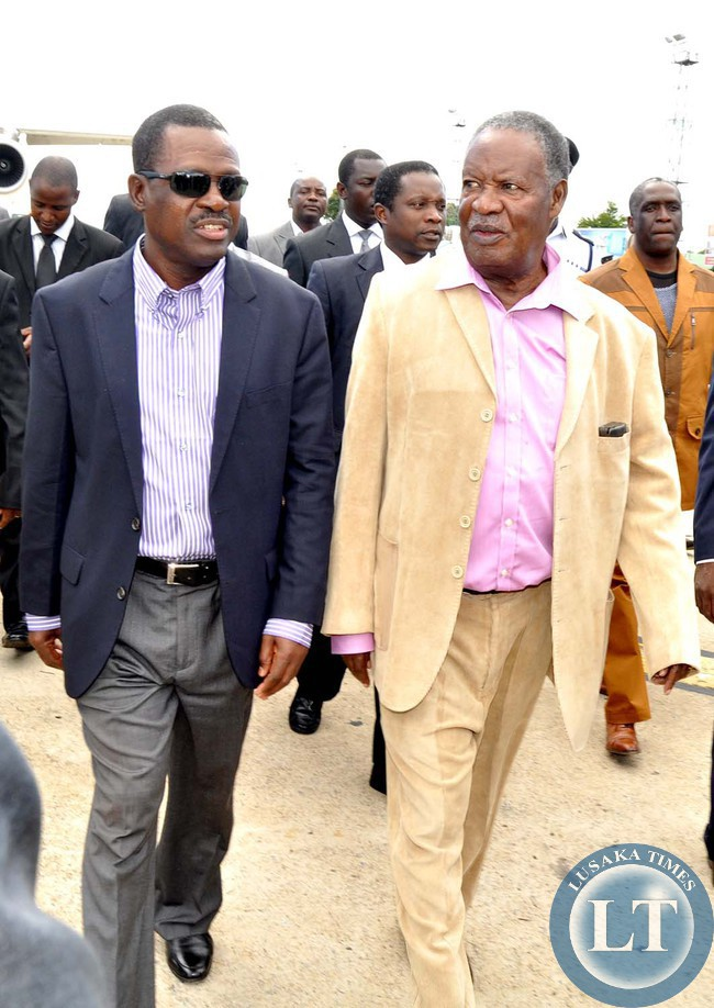 President Sata flanked by Justice minister Wynter Kabimba on arrival at Kenneth Kaunda International Airport