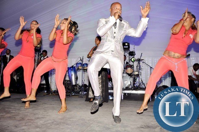 Koffi Olomide and dancing queens during the wedding ceremony of Bona Mugabe, Daughter to Robert Mugabe , President of the Republic of Zimbabwe and Simba at President Mugabe's private residence in Harare, Zimbabwe on March 1,2014 -Picture by THOMAS NSAMA