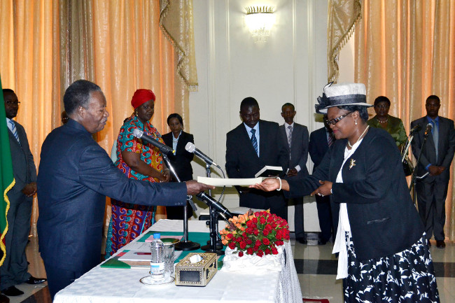 President Michael Sata receives an affidavit from newly appointed Community Development Mother and Child Deputy Minister Ingrid Mpande at State House