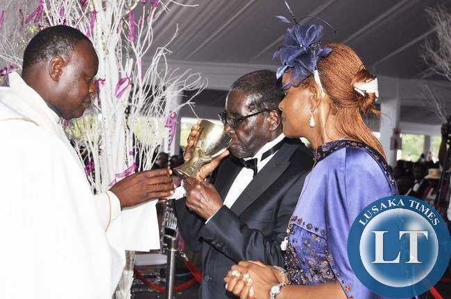 Mugabe and First Lady Grace Mugabe with Fr Clifford during the wedding ...