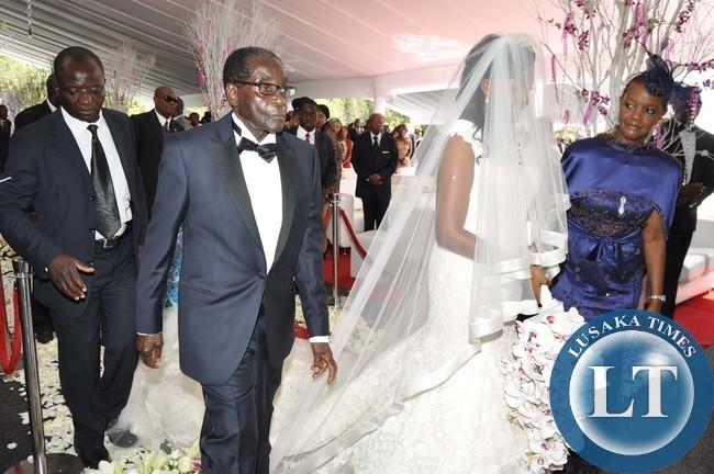 President Robert Mugabe and First Lady Grace Mugabe during the wedding ...