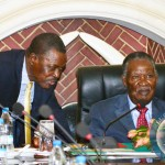 FILE: President Michael Sata listens to Justice Minister Wynter Kabimba (left) at the launch of the African Peer Review Mechanism report at State House in Lusaka