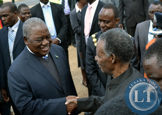 President Michael Sata shakes hands with former Republican president Rupiah Banda at the commemoration of Africa Freedom Day at the freedom statue in Lusaka