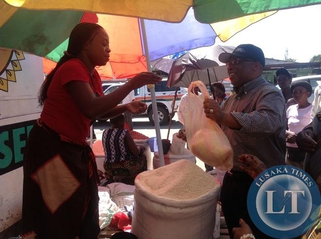 Nevers  Mumba buying commodities at Chisokone market