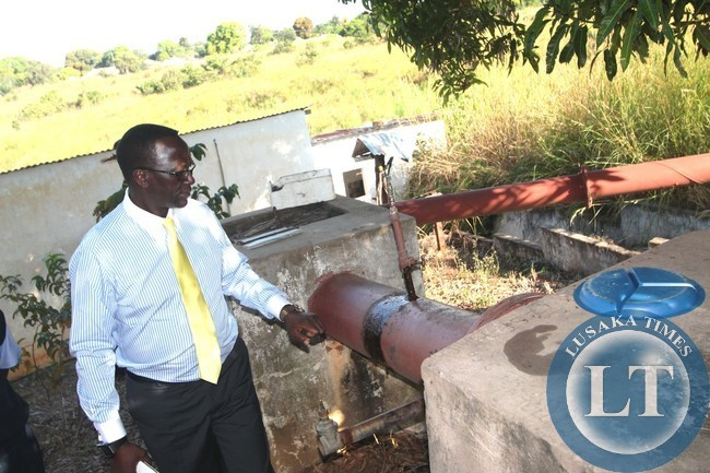 GOVERNMENT says it will revamp operations once it takes over the Mununshi Banana scheme in Mwense District. Currently, most equipment at the Banana plantation is broken down. In the picture, Luapula Province Permanent Secretary Chanda Kasolo inspects one of the broken pumps recently