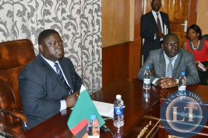 Transport, Works, Supply and Communications Minister Yamfwa Mukanga (left) addresses new Zambia Railways Board members at his office as the new Board Chairperson Davies Chama looks on in Lusaka