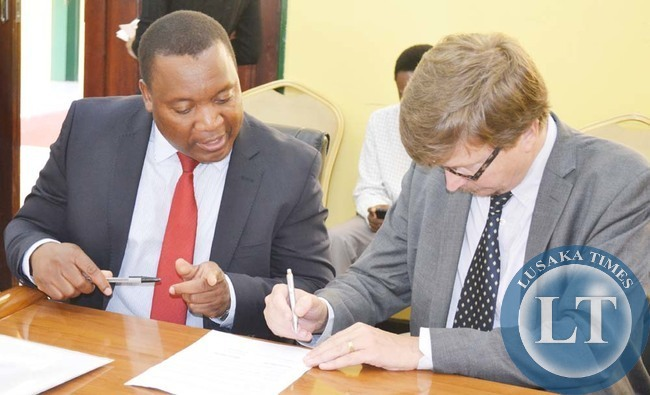 ZAMBIA National Farmers Union (ZNFU) executive director Ndambo Ndambo (left) and Finnish Ambassador to Zambia Pertti Anttinen during the signing ceremony of a Four million Euros bilateral agreement to finance the Core Support Programme (CSP) in Lusaka