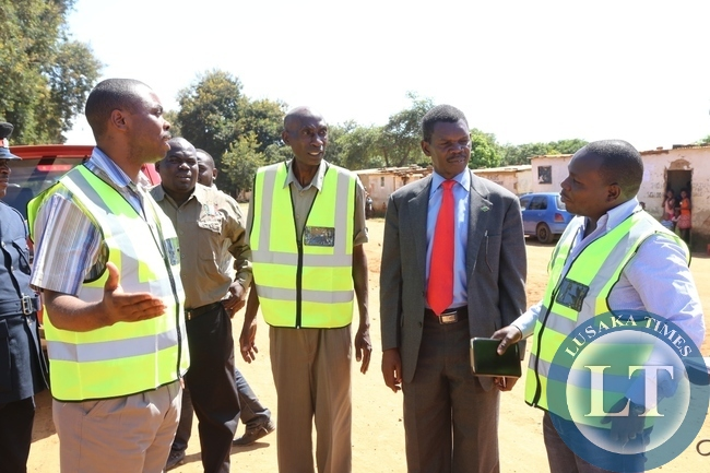 ,Lusaka Province Minister Phillip Kosamu talks to shibuyunji DC Phanwell Mweemba during the tour of roads in shibuyunji district