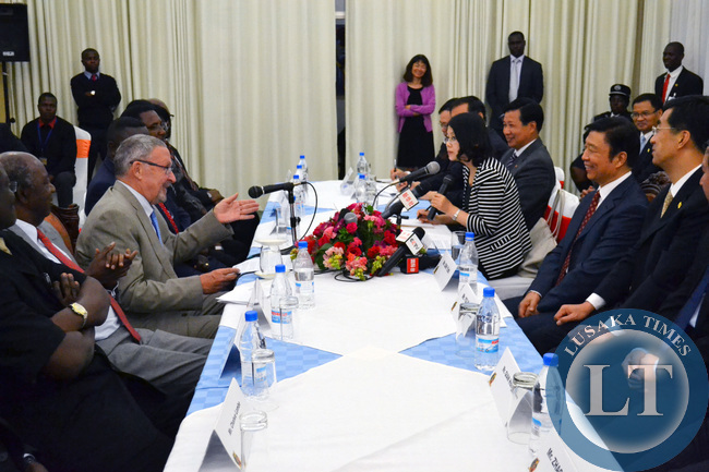 Vice President Guy Scott talks to Chinese Vice President Li Yuanchao during a meeting at Government House in Lusaka