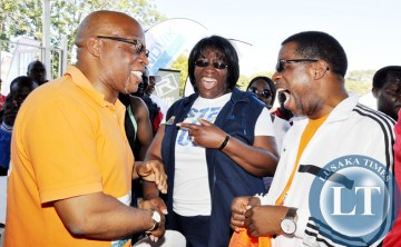 First Lady Dr Christine Kaseba share a light moment with MMD president Dr Nevers Mumba and ZAAA president Elias Mpondela (r)  during the Inter Company relay.  Dr Christine Kaseba yesterday took part in a 5 kilometre walk  in Lusaka on June 14 -Picture by THOMAS  NSAMA