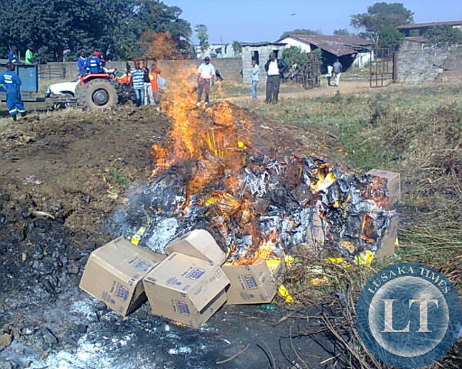 SOME corn flakes with traces of Genetically Modified Organism (GMOs) being destroyed by Luanshya Municipal Council workers at a dump site