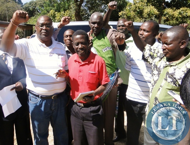 PF Northern Province acting chairperson Peter Mwansa (red) franked by Kasama District Chairman Caleb Monta offering solidarity to PF secretary general Wynter Kabimba at their party office in Kasama