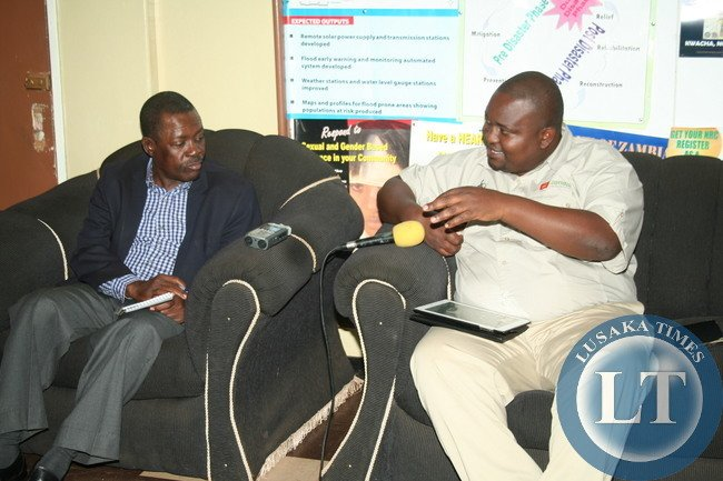 CHIPATA District Commissioner, Kalunga Zulu, briefs Justice Minister, Wynter Kabimba, when he paid a courtesy call at his office in Chipato