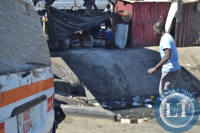 FOOD being sold less than two meters away from a nose pinching stench releasing blocked drainage at Lusaka's City market