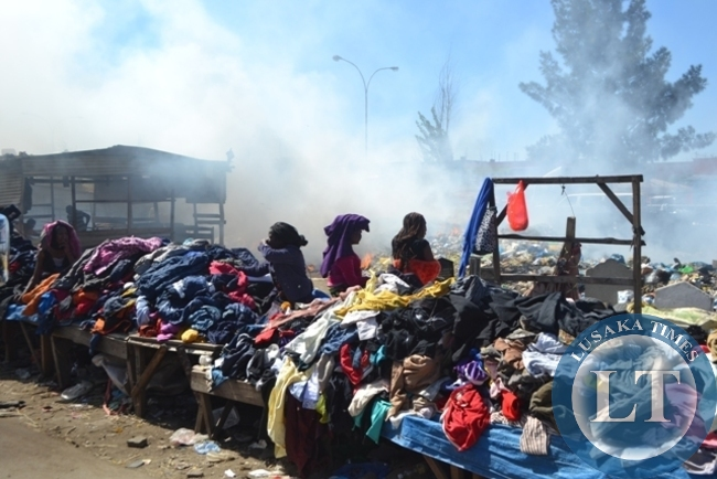 Indiscriminate disposal and burning of waste causing an obvious high pollution levels at Lusaka's City Market.