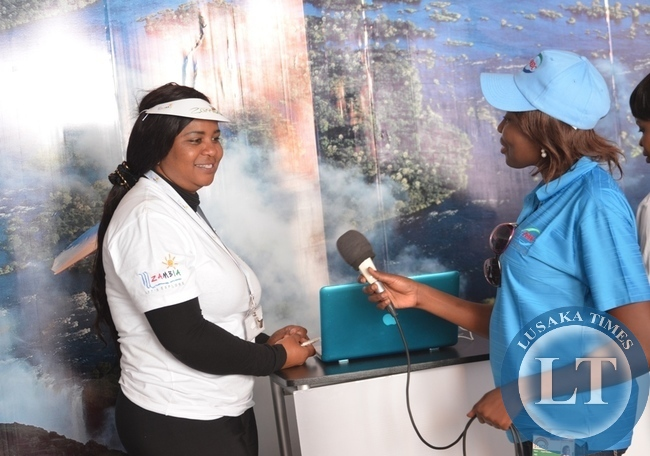 ZNBC's Angela Limwanya (right) interviewing ZTB tourism promotion manager Jocelyn Mutinta (right) at ZTB pavilion yesterday during the ongoing eighth Southern Tourism, Agricultural and Commercial Show Society (STACSS) in Livingstone