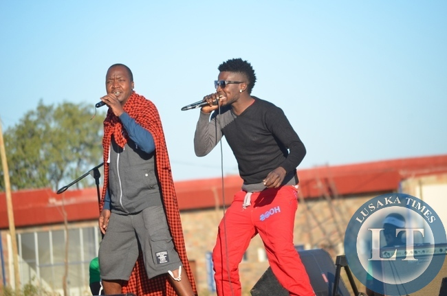 Musician Mozegeta (left) and his dancing queen (right) entertaining residents in Livingstone at the just ended 8th Southern Tourism, Agricultural and Commercial Show Society (STACSS)