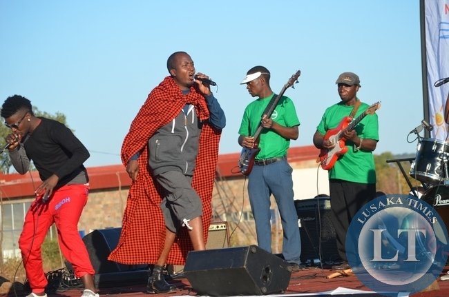 Musician Mozegeta ( second from left) and his dancing queen entertaining residents in Livingstone at the just ended 8th Southern Tourism, Agricultural and Commercial Show Society (STACSS)