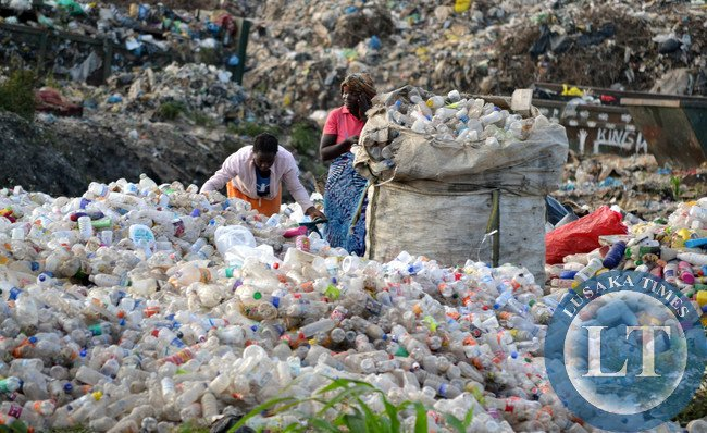 The Chingwere dump site in Lusaka has been over run by people who collect recyclable materials for sale. But the intruders, such as these women, endanger their lives because of lacking safety gear to protect themselves from the dangerous materials they come in contact with.