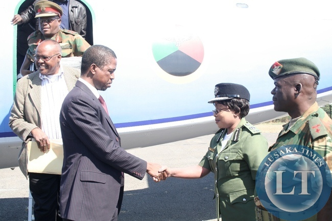 Western Province Police Commissioner Lombe Kamukoshi (c) welcomes Defense Minister Edgar Lungu (l) at Mongu Airport during an Official Visit in Mongu District, Western Province