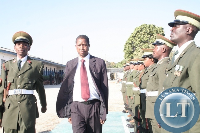 Defense Minister Edgar Lungu inspects the  Quarter Guard mounted by Zambia Army Western Region Headquarters during an Official visit in Mongu District, Western Province