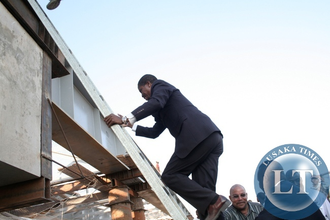 Defense Minister Edgar Lungu climbing to inspect the progress of the bridge on the Mongu –Kalabo Road Project during an Official visit in Mongu District, Western Province,