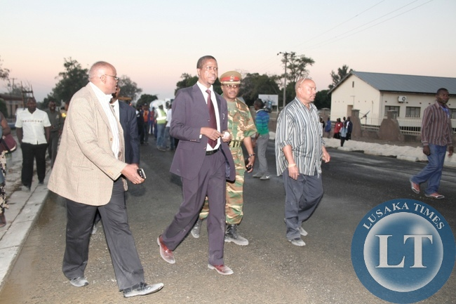 Defense Minister Edgar Lungu (c) with Western Province PS Augustine Seyuba (l) inspecting Mongu Township Road works  on Independence Road during an Official visit in Mongu District, Western Province