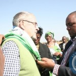 Matero MP Miles Sampa (r) dresses Vice President Dr. Guy Scott (l) a PF scarf  on arrival at Kaoma air strip to drum up support ahead of the forthcoming Mangango  August 19 2014, Parliamentary bye elections in Kaoma District, Western Province,
