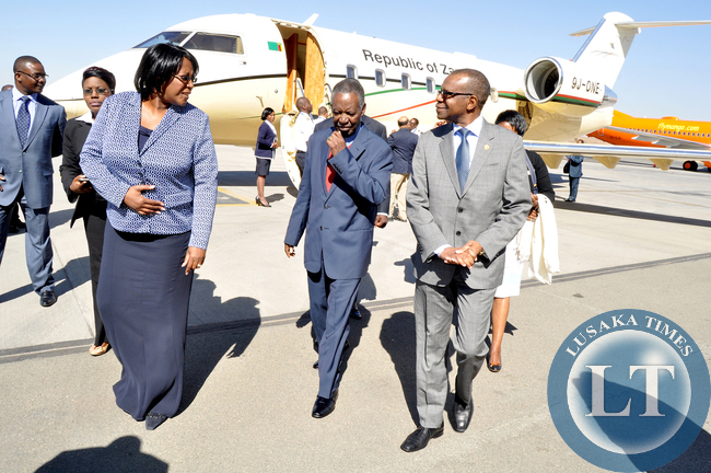 President Sata with First Lady Dr Christine Kaseba  flanked by Zambia's High Commissioner to South Africa Muyeba Chikonde on arrival at Lanseria International Airport en route to Netcare Milpark Hospital in South Africa where they visited Kazimu Sata on July 19,2014 -Picture by THOMAS NSAMA