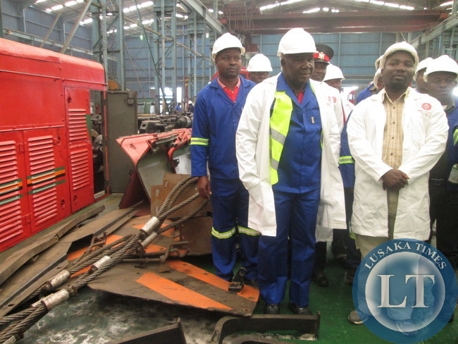 Communications , Transport, Works and Supply Deputy Minister Panji Kaunda (left) with Central Province Acting PS Ronald Sinyangwe touring Zambia Railways Workshop in Kabwe
