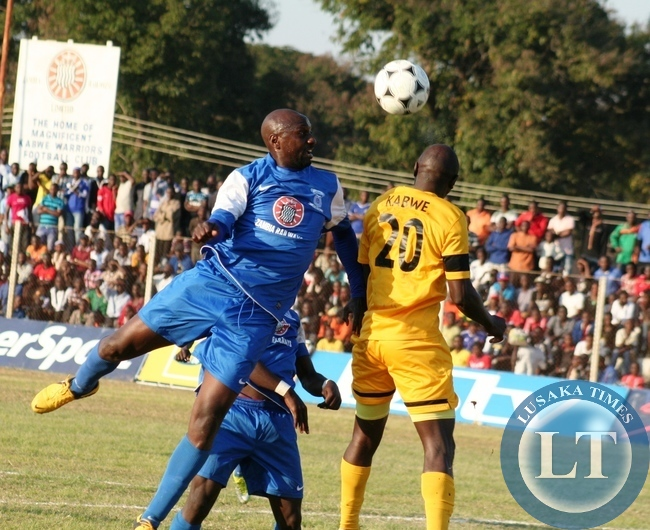 Kabwe Warriors striker Owen Mwendabai (left) in an aerial fight for the ball with Power Dynamos Defender Kamuzati Kabwe during FAZ - MTN week 16 match played at Godfrey Chitalu Stadium in Kabwe yesterday . Power beat Warriors 3- 2