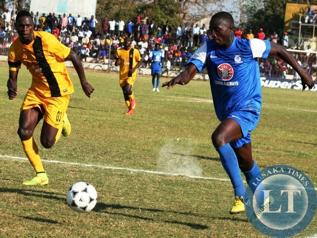 Kabwe Warriors Striker Brian Mwila (right) fighting for the Ball with Power Dynamos Defender Mutale Billy during week 16  FAZ- MTN Premier league game played at Godfrey Chitalu Stadium in Kabwe yesterday . Power won by 3 - 2