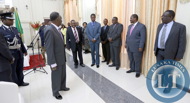 President Michael Sata talks to Ministers and officials after the Swearing in Ceremony of of Mr Musa Mwenye Attorney General and Mr Abraham Mwansa as Solicitor General at State house on Wednesday 30th July 2014- Picture by Eddie Mwanaleza.