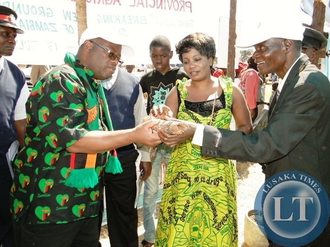 Northern Province Permanent Secretary Hlobotha Nkunika at Kaputa district Stand during the Provincial Agriculture Investment and Tourism show held at Kasama sports stadium recently. Looking on is police commissioner Charity Katanga