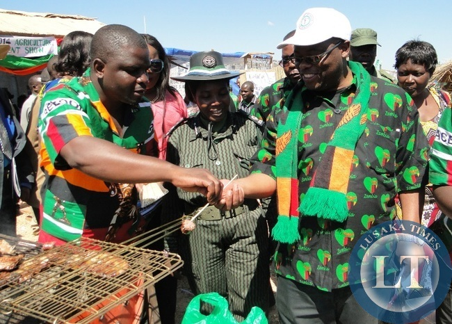 Northern Province Permanent Secretary Hlobotha Nkunika listen to an exhibitor John Mukupa during his tour of stands at the Provincial Agriculture Investment and Tourism show held at Kasama sports stadium recently. Looking on is Kasama Major John Nkumbula and Police Commissioner Charity Katanga