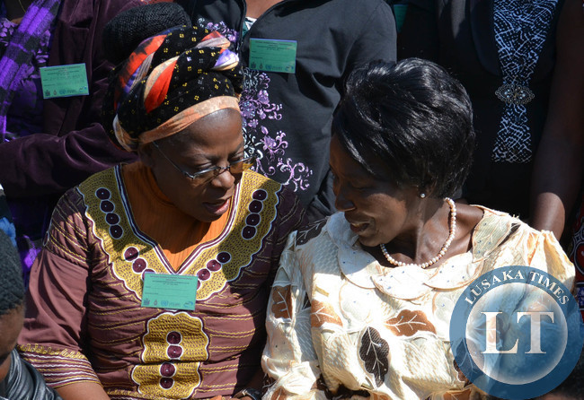 Gender and Child Development Minister Inonge Wina (right) talks to Pan Africa Women Entrepreneurship Programme President Sylvia Banda at the opening of the national women economic empowerment jubilee expo at Mulungushi International Conference Centre in Lusaka recently